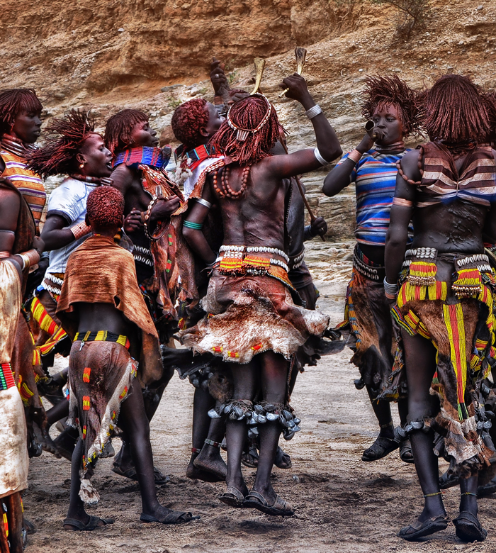 girls from hamer tribe durning the ritual dance - bull jumping ceremony